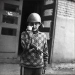 Мальчик с игрушечным автоматом. A boy with a toy machine gun.